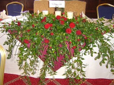 Top table arrangement reds and greens