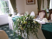 Top table arrangement whites and greens
