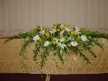 Gold and white top table arrangement